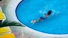 Healthy fitness. Top view of man swimming in the pool. royalty free stock photo
