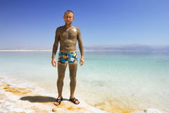 A man in swimming trunks at the beach of the dead Stock Images