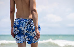 Man in swimming trunks Stock Images