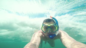 Man is swimming under the sea water stock video
