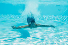 Man swimming under water royalty free stock images