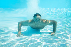 Man swimming under water royalty free stock photos