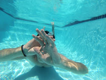 A man swimming under water Stock Photography