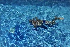Man swimming underwater Stock Photos