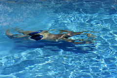 Man swimming underwater Stock Images