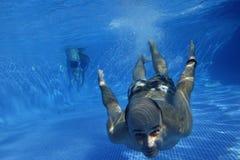 Man swimming underwater stock image