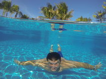 Man Swimming underwater in a swimming pool, Stock Photo