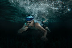 Man swimming underwater. Royalty Free Stock Photos