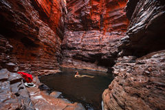 Man swimming in water hole deep in gorge Royalty Free Stock Photo