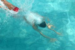 Man swimming in water pool Stock Images