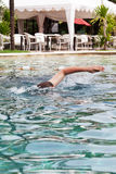 Man swims in the pool Royalty Free Stock Photography
