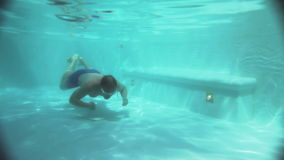 The man swims in the pool stock video