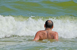 A man swims in the sea Royalty Free Stock Photography