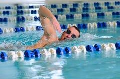 Man swims using the crawl stroke Royalty Free Stock Photography