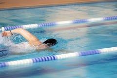 Man swims world record. Man swims in swimming pool Royalty Free Stock Photo