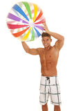 Man swimsuit with beachball over head Royalty Free Stock Photos
