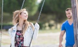 Man swinging his girl Royalty Free Stock Photo