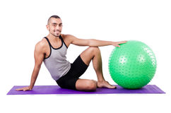 Man with swiss ball Stock Photo