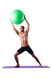 Man with swiss ball Stock Images