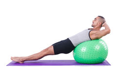 Man with swiss ball doing exercises Royalty Free Stock Photos