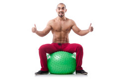 Man with swiss ball Royalty Free Stock Image