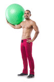 Man with swiss ball Royalty Free Stock Photos