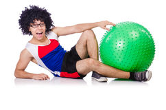 Man with swiss ball doing exercises Royalty Free Stock Photo