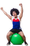 Man with swiss ball doing exercises. On white Royalty Free Stock Images