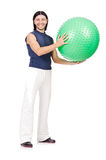 Man with swiss ball doing exercises Royalty Free Stock Image