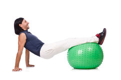 Man with swiss ball doing exercises Stock Images