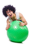 Man with swiss ball doing exercises Royalty Free Stock Images