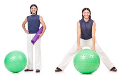 The man with swiss ball isolated on white Royalty Free Stock Photos