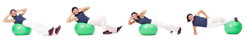Man with swiss ball isolated on white Stock Photos