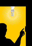 Man switching on light bulb Stock Photo