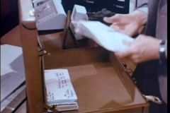 Man switching stack of envelopes stock video footage