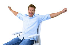 Man on swivel chair raising arms to show his success on white screen Royalty Free Stock Photos