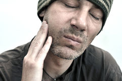 Man with swollen face suffering from toothache Stock Images