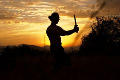 Man with sword. In sunsets Royalty Free Stock Image
