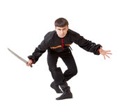 Man with a sword. Isolated on the white background Stock Photo