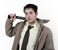 A man with a sword. A young man with a sword stock photo