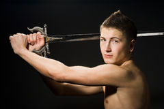Man with sword. On black background Royalty Free Stock Photography