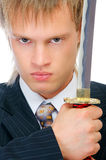Man with sword protects business Stock Photo