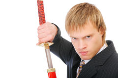 Man with sword protects business Royalty Free Stock Images