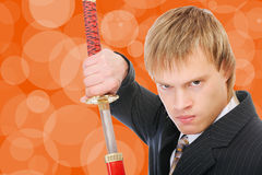 Man with sword protects business Royalty Free Stock Photography