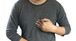 MAN with symptomatic acid reflux , suffering from acid reflux at stock photo