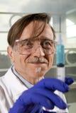 Man with syringe Stock Image
