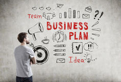 Man in T-shirt and business plan icons Royalty Free Stock Images