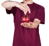 Man T-shirt Christmas ball. Isolated on white background Stock Images