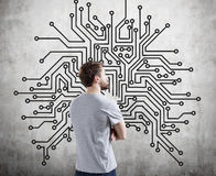 Man in T-shirt and circuit Stock Images