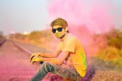 Man in T-Shirt and Jeans and Sunglasses Color Power Royalty Free Stock Image